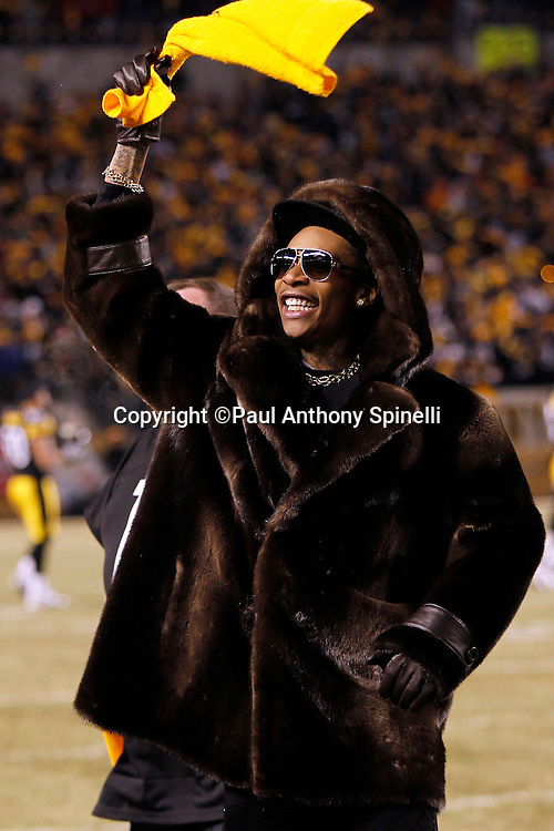 Rapper Wiz Khalifa waves a terrible towel and fires up the fans prior to the Pittsburgh Steelers NFL 2011 AFC Championship playoff football game against the New York Jets on Sunday, January 23, 2011 in Pittsburgh, Pennsylvania. The Steelers won the game 24-19. (©Paul Anthony Spinelli)