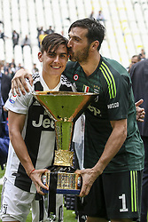 May 19, 2018 - Turin, Italy - Juventus forward Paulo Dybala (10) and Juventus goalkeeper Gianluigi Buffon (1) celebrate holding the Serie A soccer title trophy after the Serie A football match n.38 JUVENTUS - VERONA on 19/05/2018 at the Allianz Stadium in Turin, Italy. (Credit Image: © Matteo Bottanelli/NurPhoto via ZUMA Press)