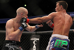 October 23, 2010; Anaheim, CA; USA; Jake Shields (blue trunks) and Martin Kampmann (black trunks) during their bout at UFC 121 at the Honda Center in Anaheim, CA.  Shields won via split decision.