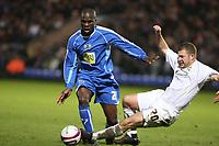 Photo: Pete Lorence/Sportsbeat Images.<br />Peterborough United v Milton Keynes Dons. Coca Cola League 2. 15/12/2007.<br />Alan Navarro slides in on Claude Gnakpa.