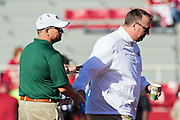 FAYETTEVILLE, AR - OCTOBER 25:  Head Coach Bill Clark of the UAB Blazers and Head Coach Bret Bielema the Arkansas Razorbacks talk before a game at Razorback Stadium on October 25, 2014 in Fayetteville, Arkansas.  The Razorbacks defeated the Blazers 45-17.  (Photo by Wesley Hitt/Getty Images) *** Local Caption *** Bill Clark; Bret Bielema