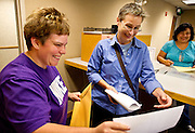 MADISON, WI - JUNE 11, 2014: Renee Currie and Shari Roll smile as they read through their certificate of marriage from Martha Garza at the Dane County Register of Deeds. Currie and Roll were the first same sex couple to be legally wed in the state of Wisconsin on Friday, June 6, 2014.