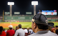 A Boston Red Sox fan wears a rally cap during a game between the Minnesota Twins and Red Sox on August 3, 2012 in Boston, Massachussetts.