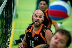 28-04-2018 NED: NK Zitvolleybal, Koog aan de Zaan<br /> vv Apollo Mill wint de kleine finale van het NK zitvolleybal met 3-2 van VC Allvo / Bas Letter #11 of Allvo