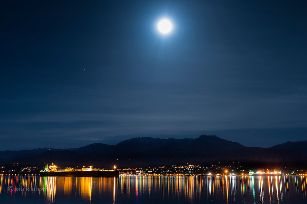 Port Angeles WA harbor at 1am under a full moon. The more distant snow-covered peaks of the Olympic Mountains are hidden in low clouds.