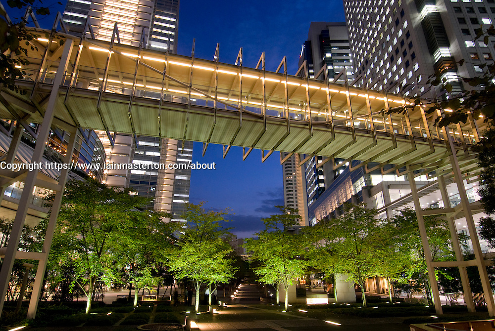 Night view of modern footbridge and urban park in Shinagawa central Tokyo