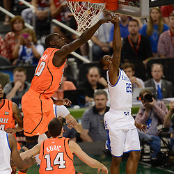 Mar 31, 2012; New Orleans, LA, USA; Kentucky Wildcats guard Marquis Teague (25) goes for lay up as Louisville Cardinals center Gorgui Dieng (10) defends during the first half in the semifinals of the 2012 NCAA men's basketball Final Four at the Mercedes-Benz Superdome. Mandatory Credit: Derick E. Hingle-US PRESSWIRE