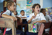 Children read words out loud during Spanish class at the primary school in the town of Coyolito, Honduras on Wednesday April 24, 2013.