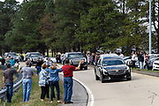 People line the entrance ramp for Route 321 from Interstate I-40, near Brookford, N.C. to honor and view the hearse carrying the body of Rev. Billy Graham as it travels from the Billy Graham Training Center at the Cove in Asheville, N.C. to the Billy Graham Library in Charlotte. N.C.on Saturday, Feb. 24, 2018. (AP Photo/Kathy Kmonicek)
