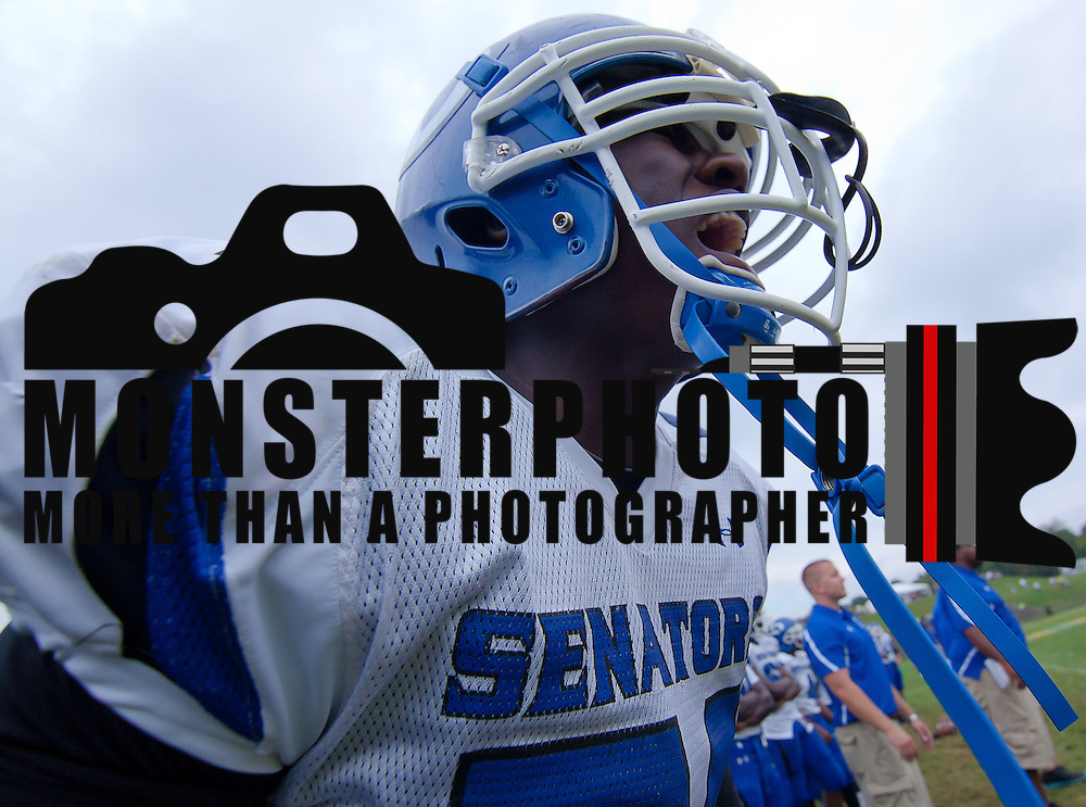 Dover linebacker Jesse Danso #54 shout from the sideline to his defensive unit in the fourth quarter of a Week 3 high school football game against St. Mark's Saturday afternoon Sept. 24, 2011 in Wilmington DE. ..The News Journal/Saquan Stimpson