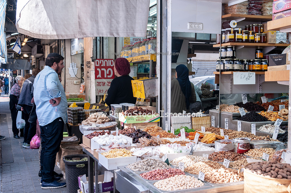 Israel, Tel Aviv, Lewinski market, Spice and herb shop in the narrow street