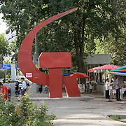 Hammer and sickle communist symbol in central Khojand, Tajikistan