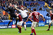 Northampton Towns keeper Adam Smith (1) gathers safely despite the attention of Bolton Wanderers Filipe Morais (22) during the EFL Sky Bet League 1 match between Bolton Wanderers and Northampton Town at the Macron Stadium, Bolton, England on 18 March 2017. Photo by Craig Galloway.