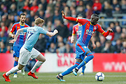 Crystal Palace midfielder Cheikhou Kouyate (8) sprints away from Manchester City midfielder Kevin De Bruyne (17) during the Premier League match between Crystal Palace and Manchester City at Selhurst Park, London, England on 14 April 2019.