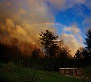 Spring rainbow over the farmstead