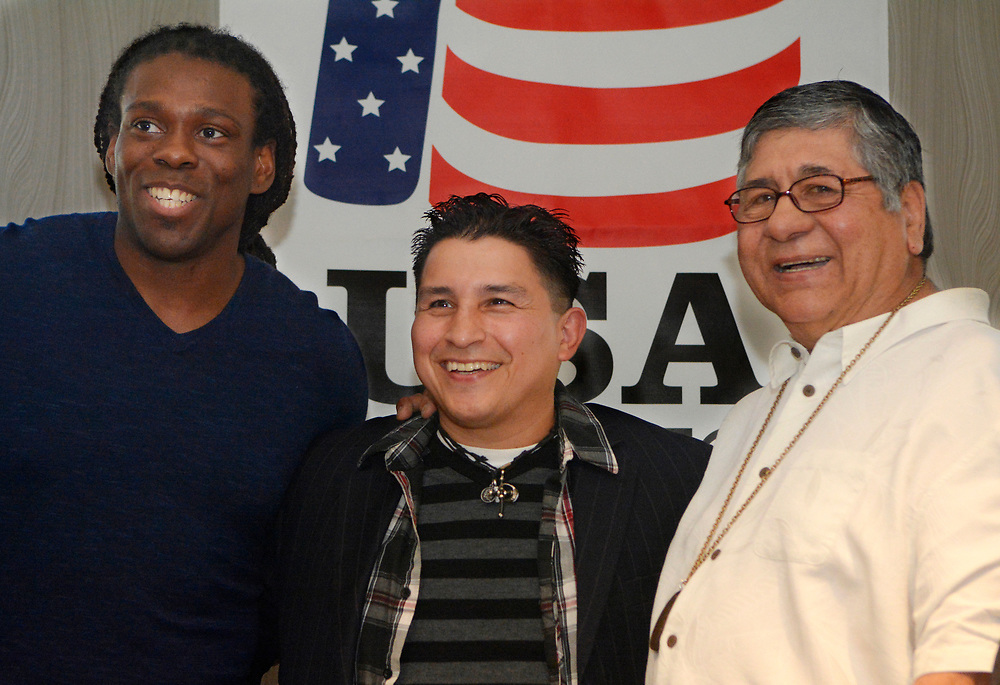 gbs032017e/SPORTS -- National champion amateur heavyweight Cam. F. Awesome, former world champion Danny Romero and Olympic bronze medalist Jesse Valdez, from left,  pose for photos after a news conference held in advance of the USA Boxing Western Elite Qualifier and Regional Open Championship at the Hyatt Hotel on Monday, March 20, 2017.(Greg Sorber/Albuquerque Journal)