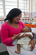 Bunono, a 4-month old baby, recently had a surgical left leg amputation following a traumatic car accident.  His mother, Princess, hugs and plays with him while he is an inpatient in Baragwanath hospital.  Baragwanath is the third biggest hospital in the world located in Johannesburg, South Africa