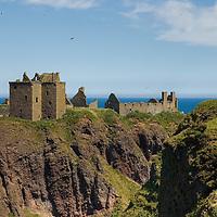 Dunnottar castle, Aberdeenshire, Scotland, on a sunny day<br />