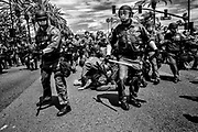 The Orange County Sherrifs Department employs swarm tactics on protesters picking them off one by one. Law enforcement was in full force during and after the event. Anaheim, Calif. May 26, 2016. (Photo by Gabriel Romero ©2016)