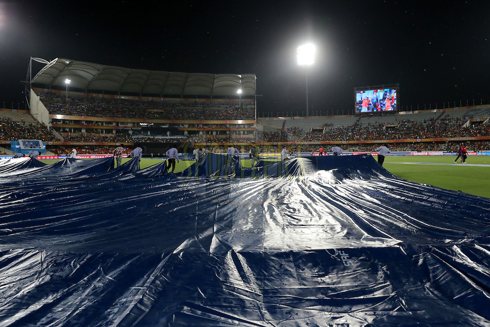 Ground men cover the pitch as rain interrupts the game  during match 22 of the Vivo IPL 2016 (Indian Premier League ) between the Sunrisers Hyderabad and the Rising Pune Supergiants held at the Rajiv Gandhi Intl. Cricket Stadium, Hyderabad on the 26th April 2016<br /> <br /> Photo by Faheem Hussain / IPL/ SPORTZPICS
