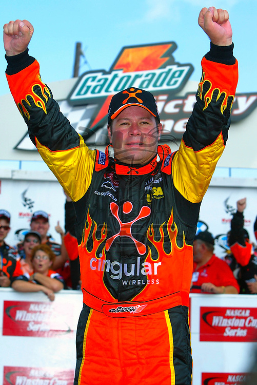 Robbie Gordon holds off the field to sweep the road coarse races for the 2003 season with a win at the Sirius At The Glen NASCAR Winston Cup race in Watkins Glen, NY. This win at the Watkins Glen International Raceway was his third career NASCAR Winston Cup victory and his second for the 2003 season.
