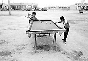 Kids playing Pool outside in a village