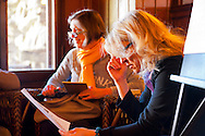 Mohonk Murder Mystery Weekend team meeting of Sam's Piano Players, with actress Alley Mulrain at right, in Lake Lounge of Mohonk Mountain House, on March 10, 2012, in New Paltz, New York, USA.