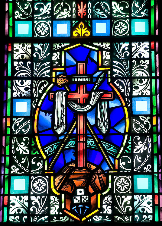 Stained glass images depicts the cross on which Jesus died and the draped cloth representing his resurrection. (Sam Lucero photo)