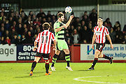 Forest Green Rovers Aarran Racine heads clear during the Vanarama National League match between Cheltenham Town and Forest Green Rovers at Whaddon Road, Cheltenham, England on 21 November 2015. Photo by Shane Healey.