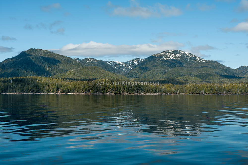 Mountains reflect in the calm waters of the Inside Passage, Alaska.
