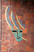 Tile art work. Originally a storehouse and remodeled into a theatre in 1930, the Floyd and Delores Jones Playhouse (originally called the Seattle Repertory Playhouse), was the very first state sponsored theatre in the nation and was home to WPA projects and the Negro Federal Theatre Projects.  It has a thrust stage and seats 210. Located at 4045 University Way NE, Seattle, Washington.