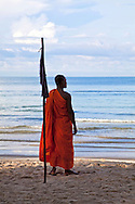 Monk at Serendipity Beach.  Even monks have to take a break every so often from a long day of meditation, chanting and gathering alms. A day at the beach is a treat for everyone.