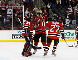 Feb 9, 2009; Newark, NJ, USA; New Jersey Devils left wing Brendan Shanahan (18) and New Jersey Devils defenseman Mike Mottau (27) congratulate New Jersey Devils goalie Scott Clemmensen (35) after his 3-0 shutout win over the New York Rangers at the Prudential Center.