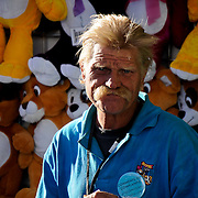 Gary Johns of Los Angeles, California, pauses at the end of a long day working as an attendant at the dart throwing booth at the Riverside County Fair and National Date Festival, in Indio, California, on Friday, February 13th, 2009.  Photo by Jen Klewitz