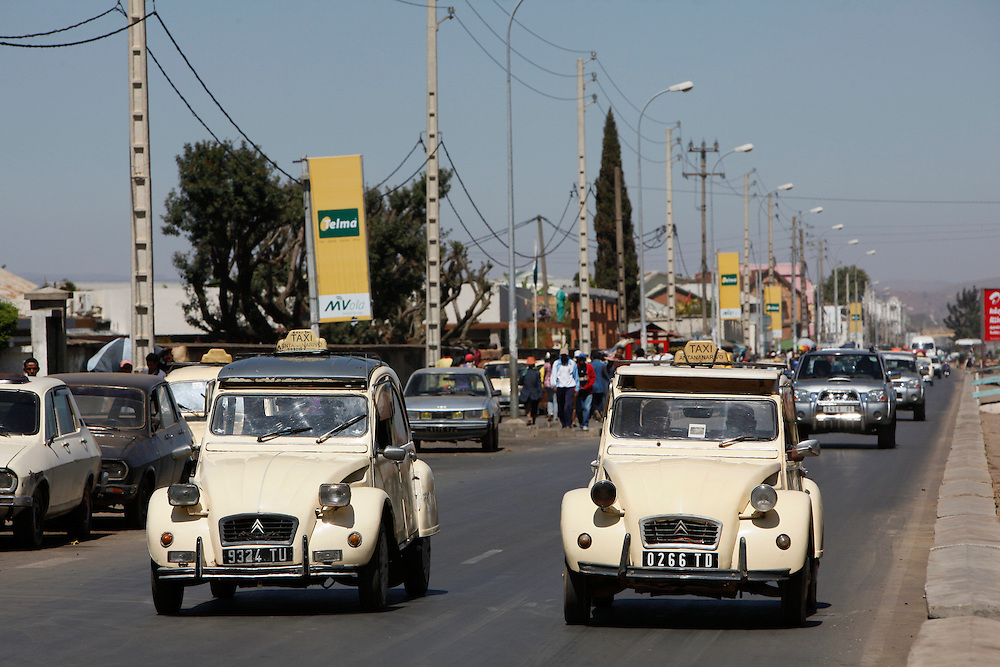 Old Citroen 2CV  taxi's.  City street scene, R Dok Rav Andrianavalona, Antananarivo. Madagascar...© Zute Lightfoot
