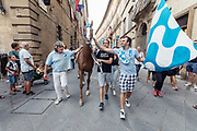 Italy, Siena, the Palio: after the Duomo the horse is taken  to the stable in the heart of the Contrada