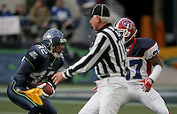 Seattle Seahawks Kris Richard(42) holds onto the ball as the back judge Don Dorkowski(113) throws the yellow flag for interfering on the play with Buffalo Bills' Jabari Greer(37) denfeding on the play. Seahawks he Buffalo Bills at Qwest Field in Seattle, November 28, 2004.