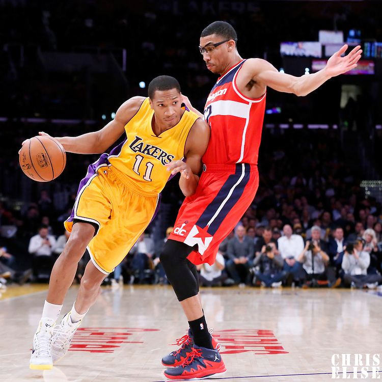 27 January 2015: Los Angeles Lakers forward Wesley Johnson (11) drives past Washington Wizards forward Otto Porter Jr. (22) during the Washington Wizards 98-92 victory over the Los Angeles Lakers, at the Staples Center, Los Angeles, California, USA.