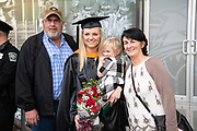 Olivia Jeffers, poses for a photo with her family after receiving a masters in nursing at Fall Commencement. Photo by Ben Siegel