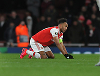Football - 2019 / 2020 UEFA Europa League - Round of Thirty-Two, Second Leg: Arsenal (1) vs. Olympiakos (0)<br /> <br /> A dejected Pierre - Emerick Aubameyamg of Arsenal, drops to his knees at the final whistle  at the Emirates Stadium.<br /> <br /> COLORSPORT/ANDREW COWIE