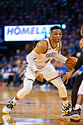 OKLAHOMA CITY, OK - APRIL 21: Russell Westbrook #0 of the Oklahoma City Thunder looks to drive during a game against the Portland Trail Blazers during Round One Game Three of the 2019 NBA Playoffs on April 21, 2019 at Chesapeake Energy Arena in Oklahoma City, Oklahoma  NOTE TO USER: User expressly acknowledges and agrees that, by downloading and or using this photograph, User is consenting to the terms and conditions of the Getty Images License Agreement.  The Trail Blazers defeated the Thunder 111-98.  (Photo by Wesley Hitt/Getty Images) *** Local Caption *** Russell Westbrook