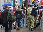 © Licensed to London News Pictures. 18/07/2012. Westminster, UK Soldiers walk among cross of tourists on Whitehall. Soldiers, police and security contractors perform security checks around Olympic sites in Westminster today, 18th July 2012. Photo credit : Stephen Simpson/LNP