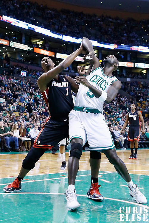 27 January 2013: Miami Heat center Chris Bosh (1) vies for the rebound with Boston Celtics power forward Kevin Garnett (5) during the Boston Celtics 100-98  2OT victory over the Miami Heat at the TD Garden, Boston, Massachusetts, USA.