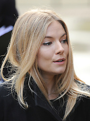 © London News Pictures. 24/11/2011. London, UK.  Actress SIENNA MILLER  arriving at The Royal Courts of Justice today (24/11/2011) to give evidence at the Leveson Inquiry into press standards. The inquiry is being lead by Lord Justice Leveson and is looking into the culture, and practice of the UK press. Photo credit : Ben Cawthra/LNP