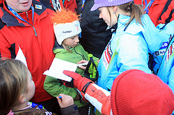First placed after second run Tina Maze of Slovenia gives autographs at Maribor women giant slalom race of Audi FIS Ski World Cup 2008-09, in Maribor, Slovenia, on January 10, 2009. (Photo by Vid Ponikvar / Sportida)
