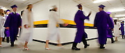 Photo by Phil Grout..Loch Raven High School seniors are a blur of caps and gowns as they.sail through the basement hallway at Towson Center and hurry on their way to the commencement ceremony.