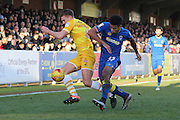 AFC Wimbledon striker Lyle Taylor (33) and Millwall defender Shaun Hutchinson (4) during the EFL Sky Bet League 1 match between AFC Wimbledon and Millwall at the Cherry Red Records Stadium, Kingston, England on 2 January 2017. Photo by Stuart Butcher.