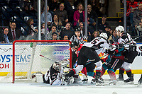 KELOWNA, CANADA - MARCH 16: Conner Bruggen-Cate #20 of the Kelowna Rockets tries to put the puck into the net of David Tendeck #30 of the Vancouver Giants on March 16, 2019 at Prospera Place in Kelowna, British Columbia, Canada.  (Photo by Marissa Baecker/Shoot the Breeze)