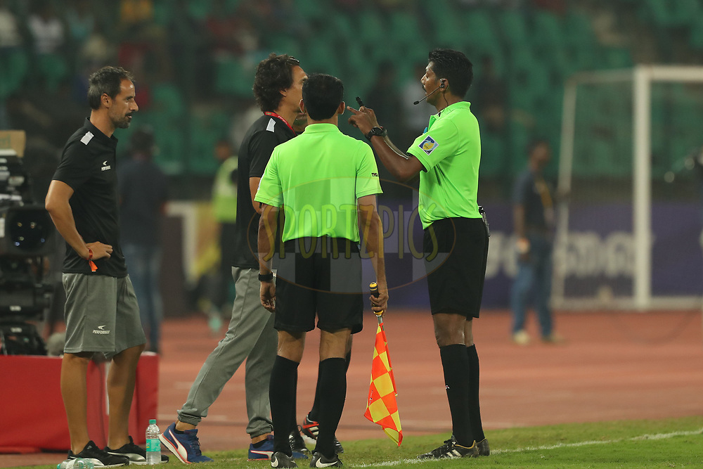 The referee has a word with Joao Carlos Pires De Deus of Northeast United FCduring match 6 of the Hero Indian Super League between Chennaiyin FC and NorthEast United FC held at the Jawaharlal Nehru Stadium, Chennai, India on the 23rd November 2017<br /> <br /> Photo by: Ron Gaunt / ISL / SPORTZPICS