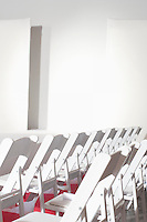 Folding chairs set out in preparation for a fashion show
